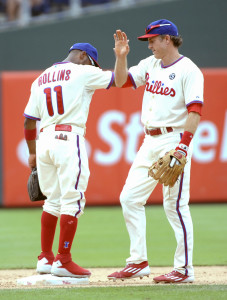 Aug 24, 2014; Philadelphia, PA, USA; Philadelphia Phillies shortstop Jimmy Rollins (11) and second baseman Chase Utley (26) celebrate the win against the St. Louis Cardinals at Citizens Bank Park. The Phillies defeated the Cardinals, 7-1. Mandatory Credit: Eric Hartline-USA TODAY Sports
