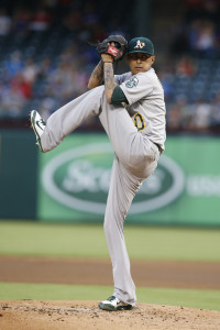 Sep 11, 2015; Arlington, TX, USA; Oakland Athletics starting pitcher Jesse Chavez (30) throws a pitch in the first inning against the Texas Rangers at Globe Life Park in Arlington. Mandatory Credit: Tim Heitman-USA TODAY Sports