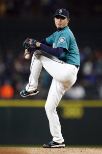 Oct 2, 2015; Seattle, WA, USA; Seattle Mariners starting pitcher Hisashi Iwakuma (18) throws out a pitch in the first inning against the Oakland Athletics at Safeco Field. Mandatory Credit: Jennifer Buchanan-USA TODAY Sports