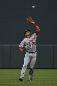 Jul 11, 2015; Baltimore, MD, USA; Washington Nationals shortstop Ian Desmond (20) catches a fly ball hit by Baltimore Orioles center fielder Adam Jones (not pictured) during the first inning at Oriole Park at Camden Yards. Mandatory Credit: Tommy Gilligan-USA TODAY Sports