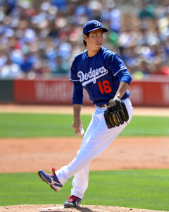 Mar 21, 2016; Phoenix, AZ, USA; Los Angeles Dodgers starting pitcher Kenta Maeda (18) pitches during the first inning against the Seattle Mariners at Camelback Ranch. Mandatory Credit: Jake Roth-USA TODAY Sports