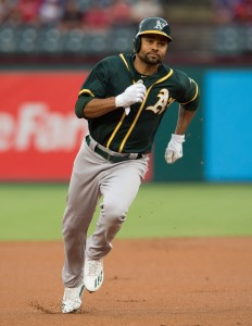 Aug 16, 2016; Arlington, TX, USA; Oakland Athletics center fielder Coco Crisp (4) runs to third base during the game against the Texas Rangers at Globe Life Park in Arlington. Mandatory Credit: Jerome Miron-USA TODAY Sports