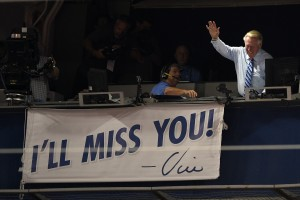 Sep 23, 2016; Los Angeles, CA, USA; American broadcaster Vin Scully reacts as a banner is unveiled during the seventh inning stretch during the game between the Los Angeles Dodgers and the Colorado Rockies at Dodger Stadium. Mandatory Credit: Kelvin Kuo-USA TODAY Sports