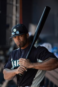 February 22, 2013; Peoria, AZ, USA; Seattle Mariners left fielder Eric Thames (10) takes practice swings in the dugout during the fourth inning against the San Diego Padres at Peoria Sports Complex. Mandatory Credit: Kyle Terada-USA TODAY Sports
